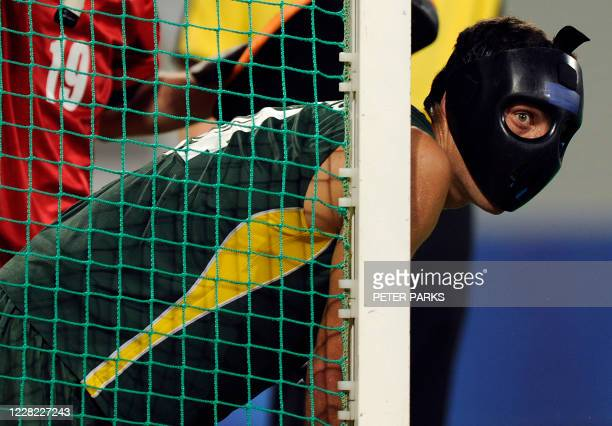 Eric Rose-Innes of South Africa concentrate for a penalty take of South Africa during their 2008 Beijing Olympic Games field hockey pool match on...