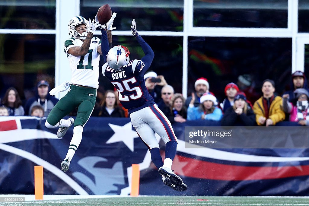 Eric Rowe #25 of the New England Patriots defends a pass intended for Robby Anderson #11 of the New York Jets during the second half at Gillette Stadium on December 24, 2016 in Foxboro, Massachusetts. The Patriots defeat the Jets 41-3.