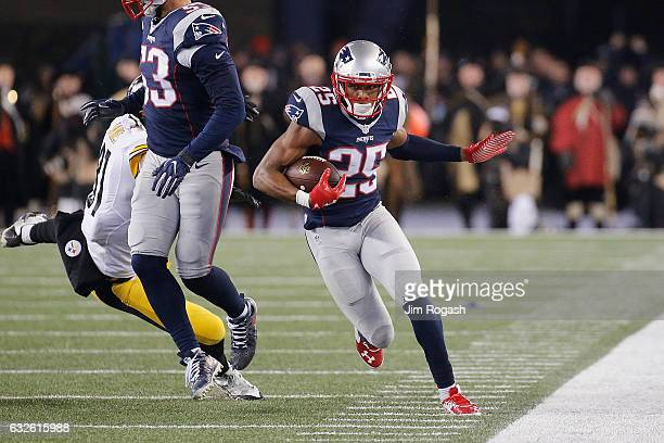 Eric Rowe of the New England Patriots runs with the ball after making an interception against the Pittsburgh Steelers in the AFC Championship Game at...