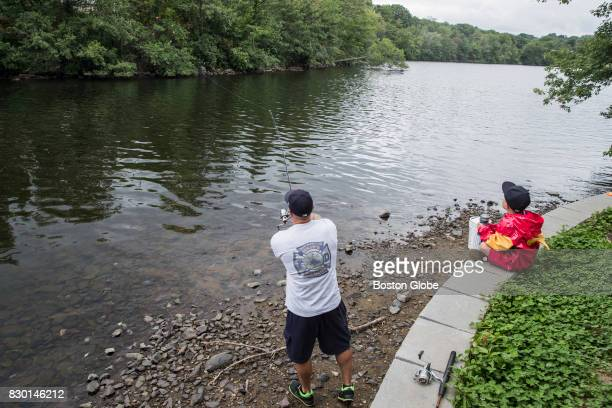 Eric Saulnier fishes with his son Crosby along the Mystic Lake in Medford MA on Aug 8 2017 Massachusetts saw a 40% increase in the number of herring...