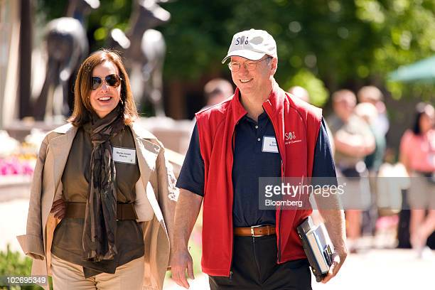 Eric Schmidt chairman and chief executive officer of Google Inc left and MarieJosee Kravis president of the New York Museum of Modern Art walk around...