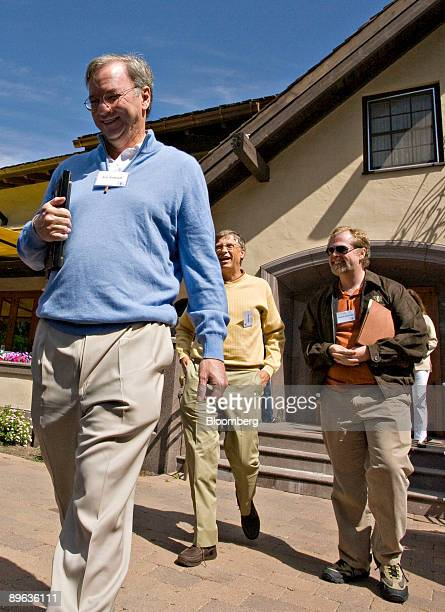 Eric Schmidt chairman and chief executive officer of Google Inc left walks ahead of Bill Gates chairman of Microsoft Corp center and Nathan Myhrvold...