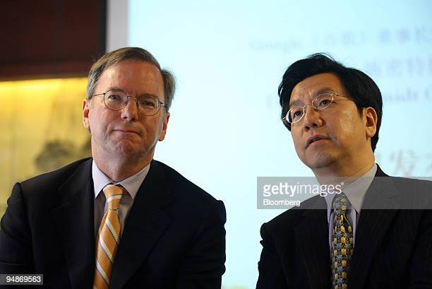 Eric Schmidt chairman and chief executive officer of Google Inc left listens as Lee KaiFu vice president of Google Inc and president of Google Inc in...