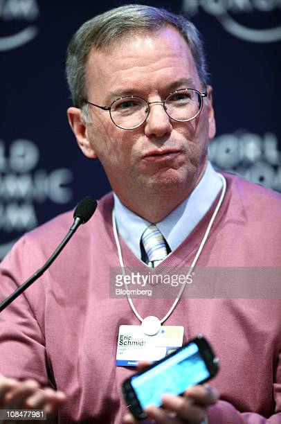Eric Schmidt chairman and chief executive officer of Google Inc shows his Android powered smartphone as he speaks during a session on the third day...