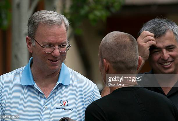 Eric Schmidt chairman of Google Inc left chats with Aviv Vivi Nevo venture Capitalist with NV Investments center while Eddy Cue senior vice president...