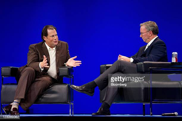 Eric Schmidt chairman of Google Inc right listens as Marc Benioff chairman and chief executive officer of SalesForcecom Inc speaks at the DreamForce...