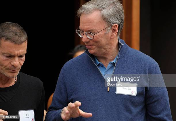 Eric Schmidt chairman of Google Inc right speaks with Aviv Vivi Nevo of NV Investments at the Allen Co Media and Technology Conference in Sun Valley...