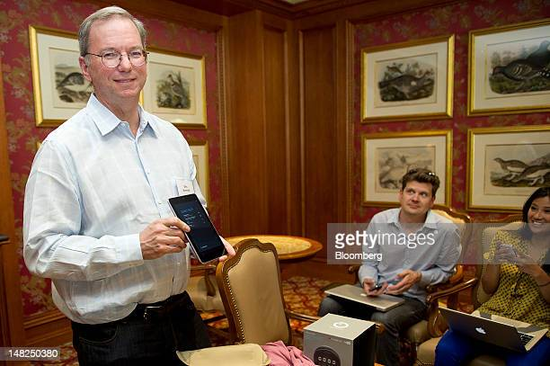 Eric Schmidt executive chairman of Google Inc holds the Google Inc Nexus 7 tablet computer as he speaks to members of the media during the Allen Co...