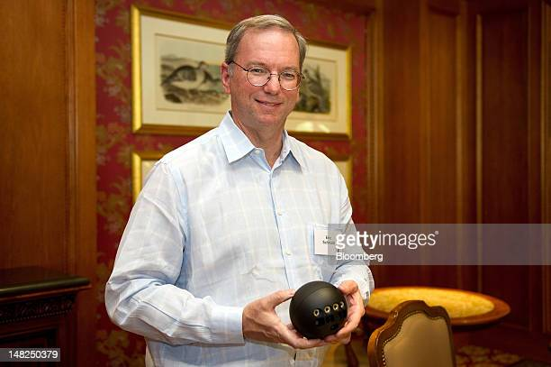 Eric Schmidt executive chairman of Google Inc holds the Google Inc Nexus Q as he speaks to members of the media during the Allen Co Media and...