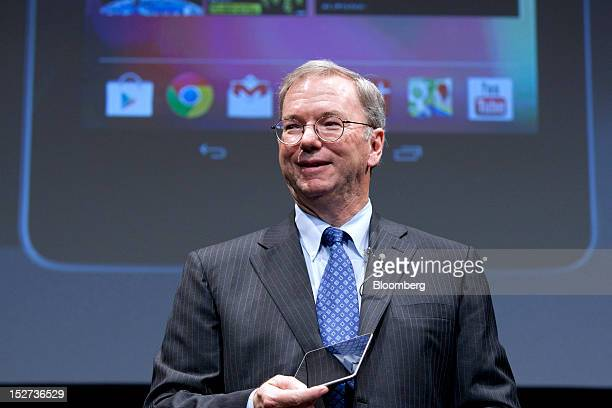 Eric Schmidt executive chairman of Google Inc holds the Nexus 7 tablet computer while he speaks during a news conference in Tokyo Japan on Tuesday...
