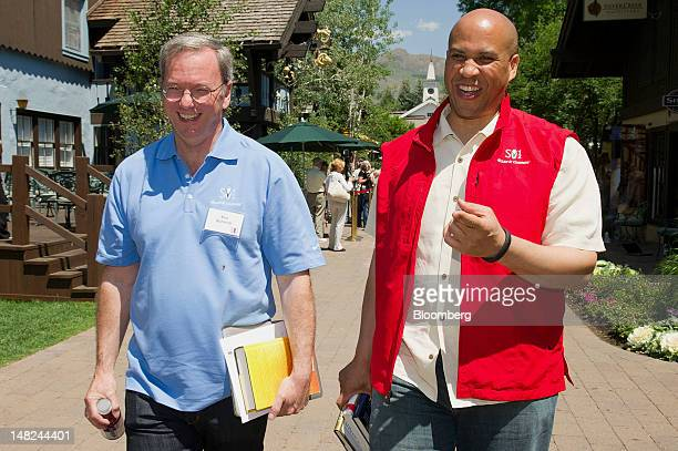 Eric Schmidt executive chairman of Google Inc left and Newark Mayor Cory Booker walk the grounds during the Allen Co Media and Technology Conference...