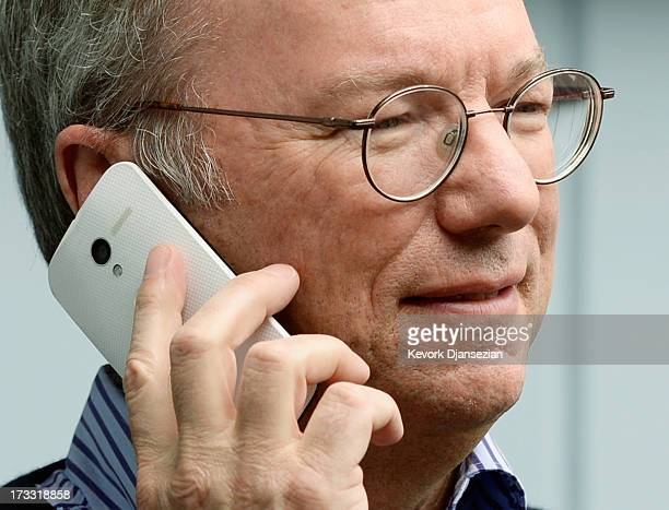 Eric Schmidt executive chairman of Google makes a call on the still to be released Google produced Moto X phone during the Allen Co annual conference...