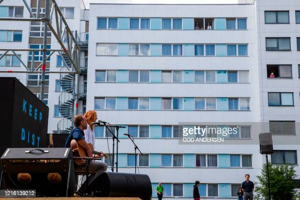 Eric Schmitt and Marleen Lohse play for German President Frank-Walter Steinmeier, his wife Elke Buedenbender and local residents attending the...