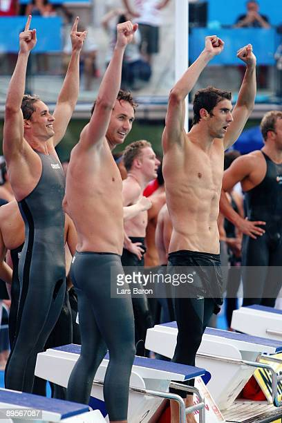 Eric Shanteau, Aaron Peirsol and Michael Phelps of the United States celebrate victory in the Men's 4x 100m Medley Relay Final during the 13th FINA...