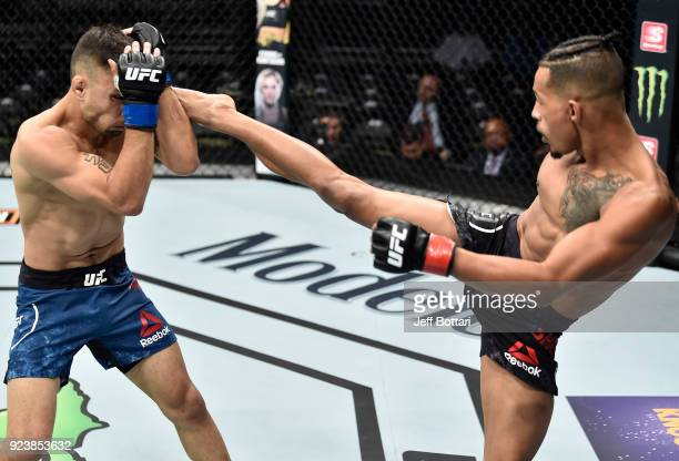 Eric Shelton kicks Alex Perez in their flyweight bout during the UFC Fight Night event at Amway Center on February 24 2018 in Orlando Florida