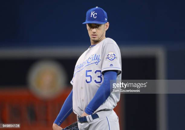 Eric Skoglund of the Kansas City Royals makes adjustments as he stands on the mound during MLB game action against the Toronto Blue Jays at Rogers...