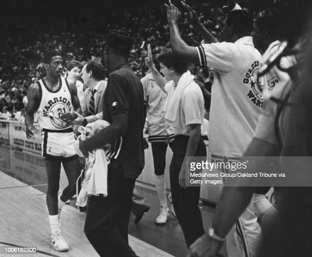 Eric 'Sleepy' Floyd gets congratulations from coach George Karl and other Warriors during the fourth quarter in Game 4 of the playoffs against the...