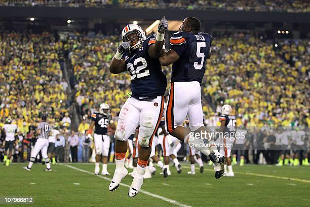 Eric Smith and Michael Dyer of the Auburn Tigers celebrate a second quarter safety against the Oregon Ducks during the Tostitos BCS National...