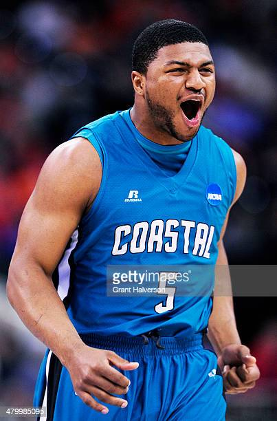 Eric Smith of the Coastal Carolina Chanticleers reacts in the first half against the Virginia Cavaliers during the Second Round of the 2014 NCAA...