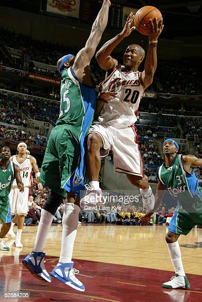 Eric Snow of the Cleveland Cavaliers drives against Erick Dampier of the Dallas Mavericks on April 3 2005 at Gund Arena in Cleveland Ohio NOTE TO...