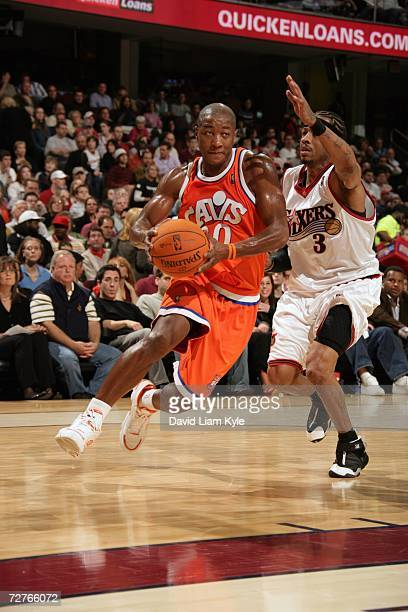 Eric Snow of the Cleveland Cavaliers drives to the basket against Allen Iverson of the Philadelphia 76ers at The Quicken Loans Arena on November 25...