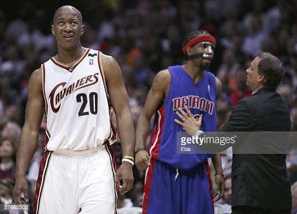 Eric Snow of the Cleveland Cavaliers reacts after he is called for a foul as Richard Hamilton and head coach Flip Saunders of the Detroit Pistons...