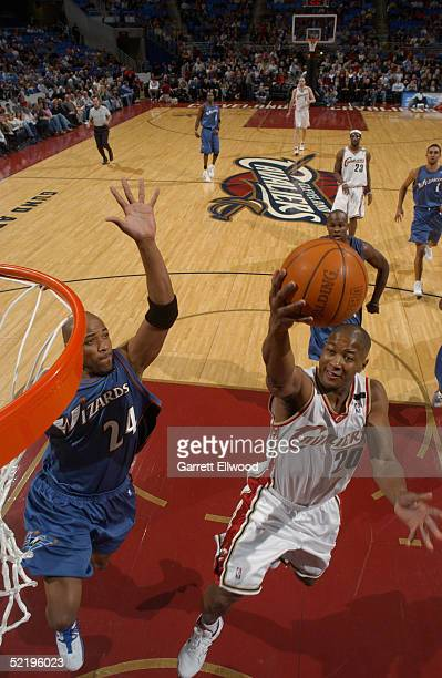 Eric Snow of the Cleveland Cavaliers shoots against Jarvis Hayes of the Washington Wizards during the game at Gund Arena on January 24 2005 in...