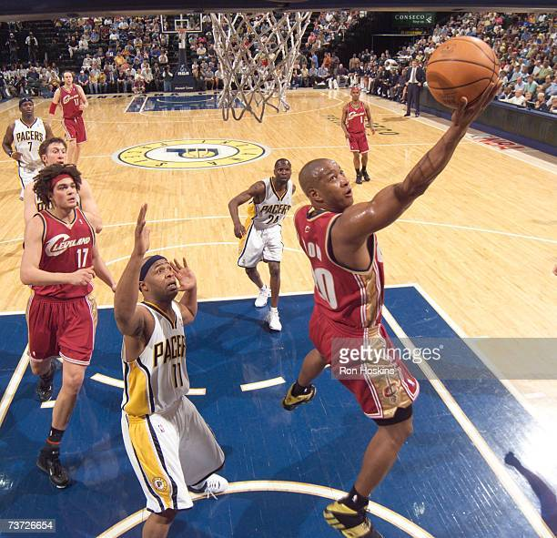 Eric Snow of the Cleveland Cavaliers shoots over Jamaal Tinsley of the Indiana Pacers at Conseco Fieldhouse on March 27 2007 in Indianapolis Indiana...