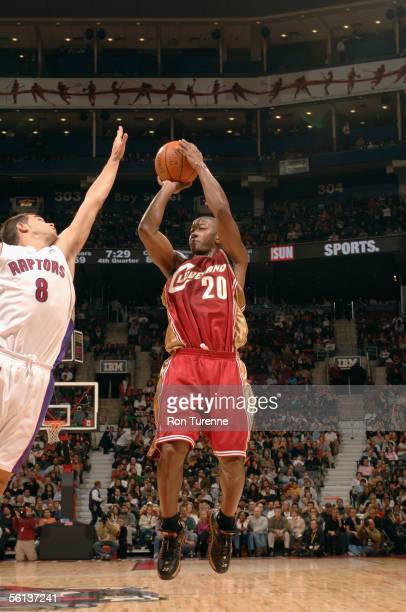 Eric Snow of the Cleveland Cavaliers shoots over Jose Calderon of the Toronto Raptors during the game at Air Canada Centre on November 7 2005 in...