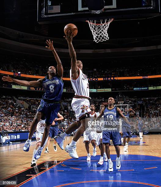 Eric Snow of the Philadelphia 76ers goes for a layup against Latrell Sprewell of the Minnesota Timberwolves during the game at Wachovia Center on...