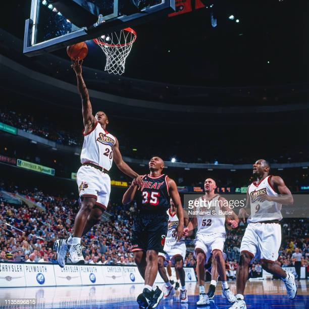 Eric Snow of the Philadelphia 76ers goes to the basket against the Miami Heat on March 5 1999 at the First Union Center in Philadelphia Pennsylvania...