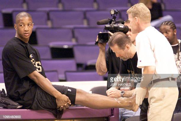 Eric Snow of the Philadelphia 76ers has his broken ankle worked on 05 June 2001 before practice for the NBA Finals at the Staples Arena in Los...