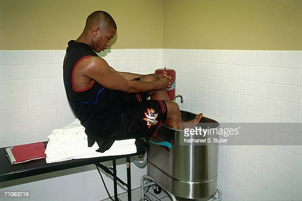 Eric Snow of the Philadelphia 76ers ices his foot prior to game one of the 2001 NBA Finals against the Los Angeles Lakers played on June 6 2001 at...
