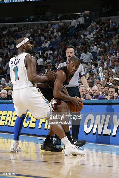 Eric Snow of the Philadelphia 76ers looks to pass while defended by Baron Davis of the New Orleans Hornets in Game four of the Eastern Conference...