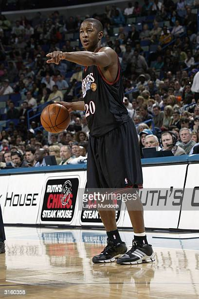 Eric Snow of the Philadelphia 76ers points while moving the ball during the game against the New Orleans Hornets at New Orleans Arena on March 17...
