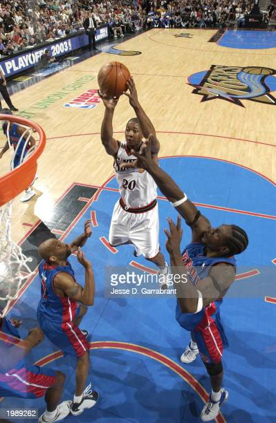 Eric Snow of the Philadelphia 76ers shoots against Ben Wallace of the Detroit Pistons in Game 3 of the Eastern Conference Semifinals of the 2003 NBA...