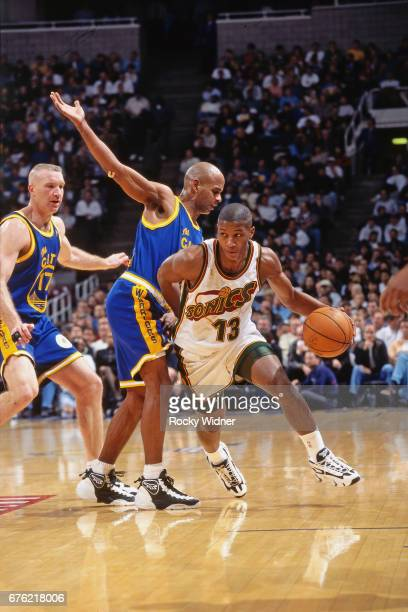 Eric Snow of the Seattle SuperSonics dribbles against the Golden State Warriors circa 1997 at Key Arena in Seattle Washington NOTE TO USER User...