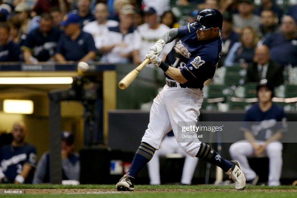 Eric Sogard #18 of the Milwaukee Brewers hits a double in the fifth inning against the Pittsburgh Pirates at Miller Park on September 12, 2017 in Milwaukee, Wisconsin.