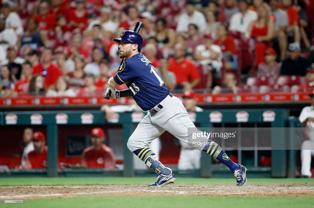 Eric Sogard #18 of the Milwaukee Brewers hits a RBI sacrifice fly in the 9th inning against the Cincinnati Reds at Great American Ball Park on June 28, 2018 in Cincinnati, Ohio.