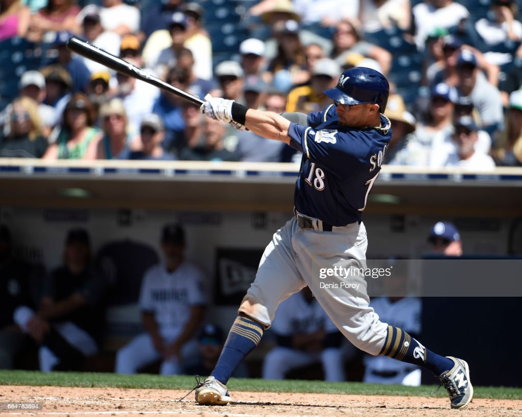 Eric Sogard #18 of the Milwaukee Brewers hits an RBI double during the seventh inning of a baseball game against the San Diego Padres at PETCO Park on May 18, 2017 in San Diego, California.