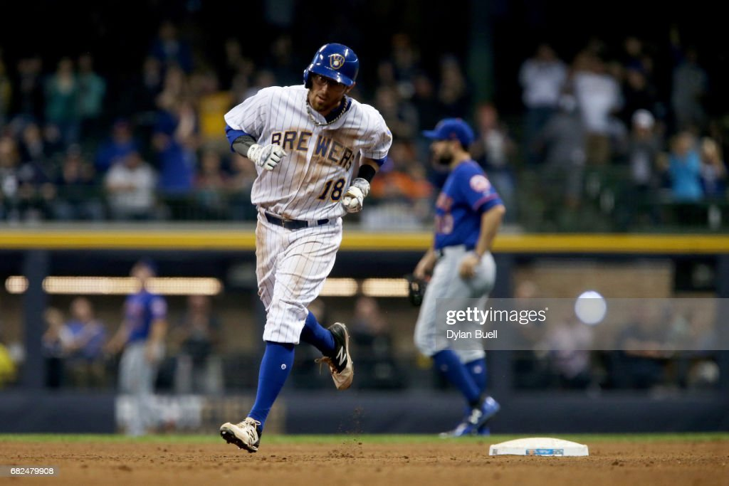 Eric Sogard #18 of the Milwaukee Brewers rounds the bases after hitting a home run in the sixth inning against the New York Mets at Miller Park on May 12, 2017 in Milwaukee, Wisconsin.