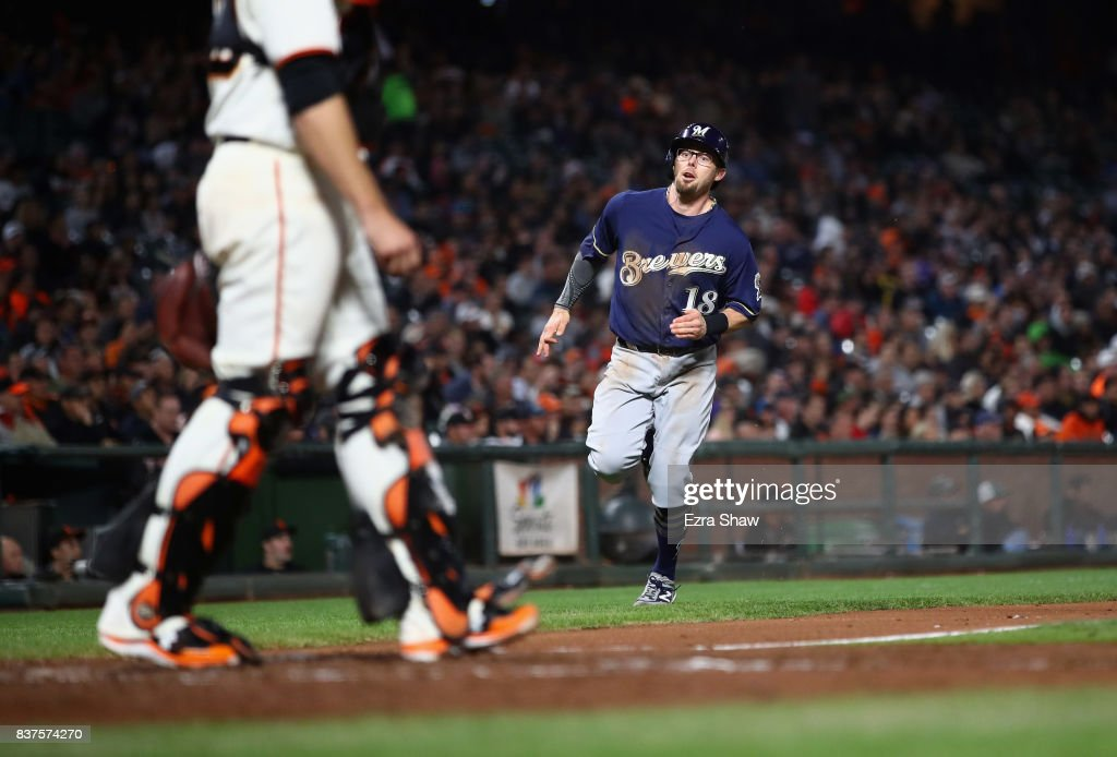 Eric Sogard #18 of the Milwaukee Brewers runs home to score in the fourth inning against the San Francisco Giants at AT&T Park on August 22, 2017 in San Francisco, California.