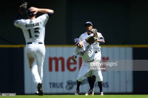 Eric Sogard of the Milwaukee Brewers runs into Keon Broxton while fielding a fly ball during the second inning of a game against the Pittsburgh...