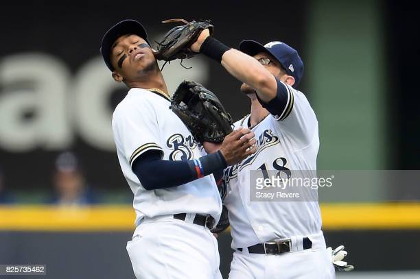 Eric Sogard of the Milwaukee Brewers runs into Orlando Arcia as he fields a fly ball during the first inning at Miller Park on August 2 2017 in...