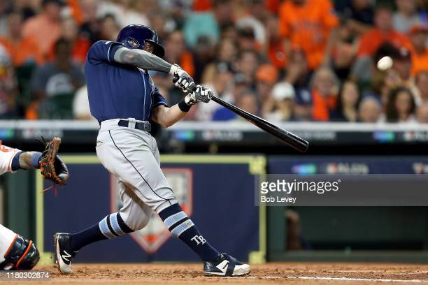 Eric Sogard of the Tampa Bay Rays hits a solo home run against the Houston Astros during the second inning in game five of the American League...
