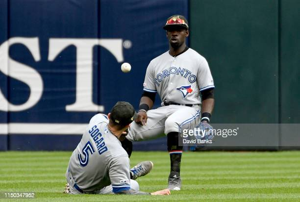 Eric Sogard of the Toronto Blue Jays and Jonathan Davis of the Toronto Blue Jays can't catch a sinle hit by Tim Anderson of the Chicago White Sox...
