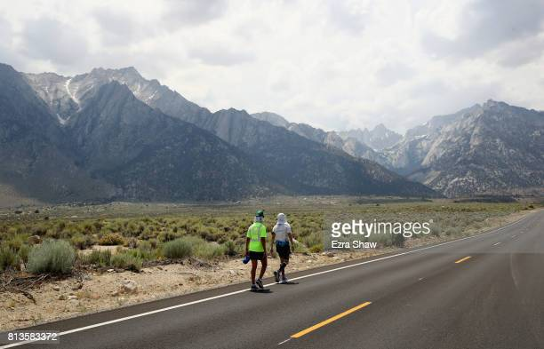 Eric Spencer and a member of his support crew walk to the Whitney Portal during the STYR Labs Badwater 135 on July 12 2017 in Death Valley California...