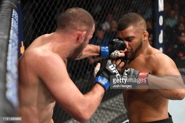Eric Spicely punches Deron Winn in their middleweight bout during the UFC Fight Night event at Bon Secours Wellness Arena on June 22 2019 in...