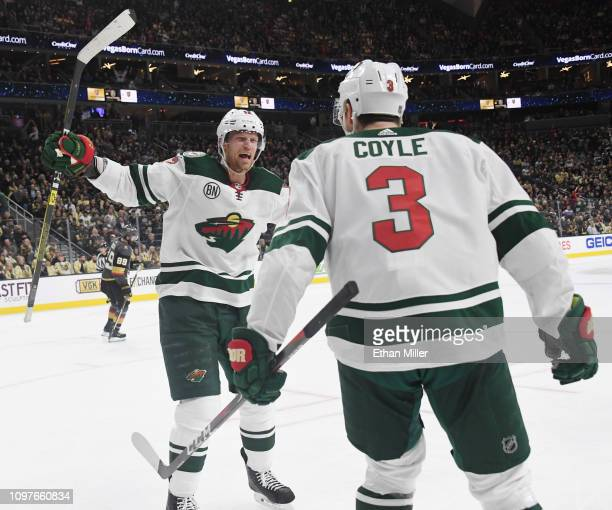Eric Staal and Charlie Coyle of the Minnesota Wild celebrate after Staal assisted Coyle on a thirdperiod goal against the Vegas Golden Knights during...