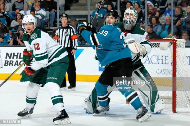 Eric Staal and Devan Dubnyk of the Minnesota Wild defend Logan Couture of the San Jose Sharks at SAP Center on April 7 2018 in San Jose California